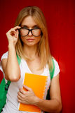 Student adjusts glasses on empty background royalty free stock image