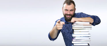 Student adult beard man with stack of book Stock Photos