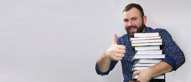Student adult beard man with stack of book royalty free stock photography