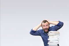 Student adult beard man with stack of book Stock Images