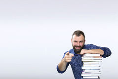 Student adult beard man with stack of book in a library Stock Images