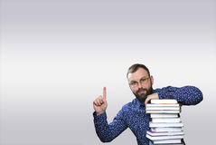 Student adult beard man with stack of book in a library Royalty Free Stock Photo