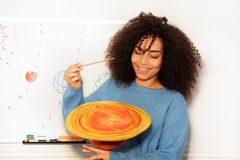 Student African girl showing Saturn planet ng royalty free stock photos