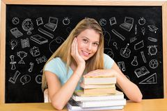 Student against black board with graphics Royalty Free Stock Image