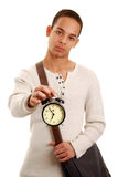 Student with alarm clock Royalty Free Stock Photos