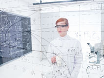 Student analyzing data and formulas Royalty Free Stock Photos