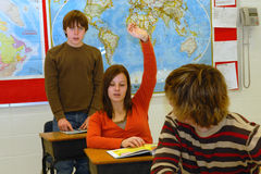 Student with Answer 3. A student raises her hand in class Stock Photos