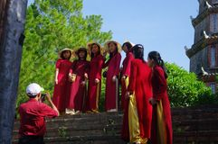 Student in Ao Dai costume. A group of students in formal attire are coming to the pagoda on the eve of the exam to pray for their success Stock Photography