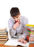 Student with an Apple. Student preparing for Exam at the School Desk on the White Background Royalty Free Stock Photos