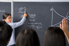 Student asking to teacher Stock Image