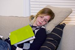 Student asleep on couch. Royalty Free Stock Photo