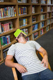 Student asleep in the library with book on his face Stock Images