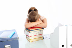 Student asleep on a pile of books Royalty Free Stock Photo