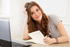 Student. Attractive girl by the table Royalty Free Stock Photo