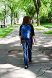 Student with back pack walking to class. Student walking on campus to class Royalty Free Stock Photos