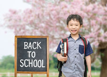 Student with back to school board Stock Image