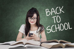 Student back to school and texting in class Royalty Free Stock Image