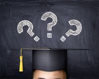 Student in the background of the school board where the question marks are drawn. 3d illustration Royalty Free Stock Photos
