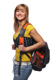 Student with backpack. Young student woman carrying a backpack and smiling isolated on a white background royalty free stock photo