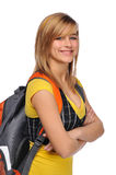Student with backpack. Young student woman carrying a backpack and smiling isolated on a white background royalty free stock photos