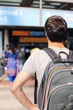 Student with backpack in airport Royalty Free Stock Photo