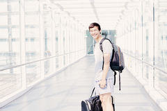 Student with backpack in airport corridor Royalty Free Stock Image