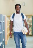 Student With Backpack And Books In Bookstore Royalty Free Stock Image