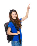 Student with backpack and finger up Royalty Free Stock Image