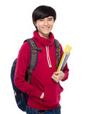 Student with backpack and handbook Royalty Free Stock Photo