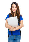 Student with backpack and laptop computer Stock Photo