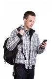 Student with backpack and mobile phone Royalty Free Stock Photography