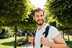 Student with backpack outside stock photo