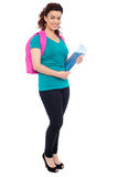 Student with backpack and spiral notebook Royalty Free Stock Photos