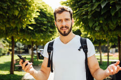 Student with backpack talking at cellphone stock photos