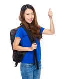 Student with backpack and thumb up Royalty Free Stock Photo