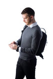 Student with backpack using smartphone Royalty Free Stock Photo