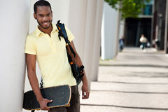 Student with Bag and Skateboard Stock Photo
