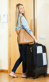 Student with baggage ready to leave town for weekend Royalty Free Stock Images