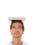 Student balancing a book on his head Royalty Free Stock Photography
