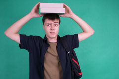 Student balancing books Royalty Free Stock Photos
