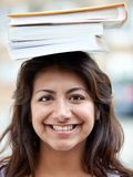 Student balancing books Royalty Free Stock Image