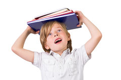 Student balancing books on his head Stock Image