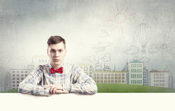 Student with banner. Young man with white blank banner. Place for text Stock Image