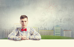 Student with banner. Young man with white blank banner. Place for text Stock Photography