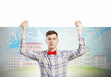 Student with banner. Young man with white blank banner. Place for text Stock Images