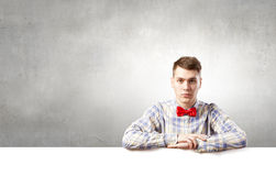 Student with banner. Young man with white blank banner. Place for text Stock Photo