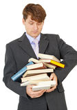 Student bears big pile of textbooks in hands Royalty Free Stock Image