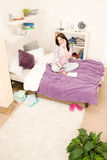 Student bedroom - young girl speaking on phone Royalty Free Stock Image