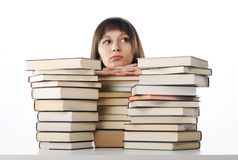 Student behind a big pile of books Royalty Free Stock Image
