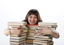 Student behind a big pile of books Royalty Free Stock Photo